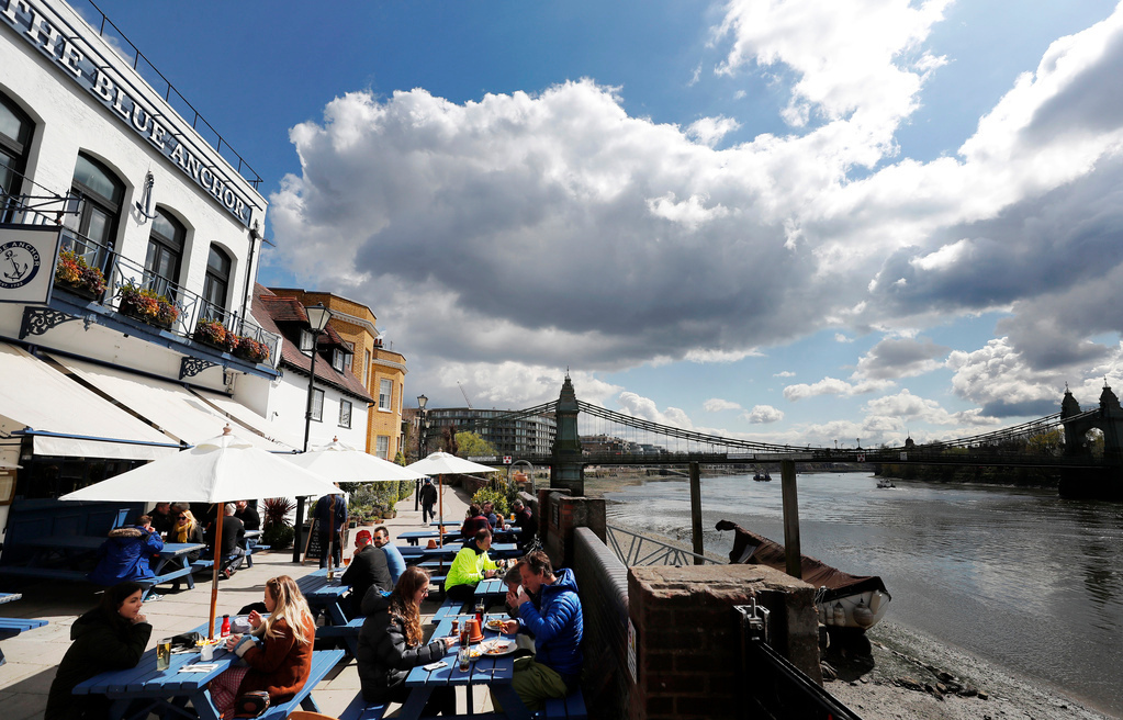 Pints and haircuts: Britain revels in relaxed lockdown