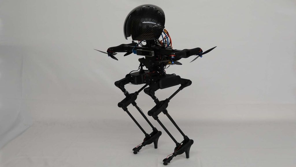 Flying robot can also ride a skateboard and balance on a rope